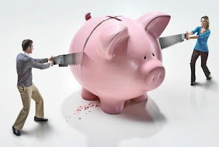 K'Mich Weddings - wedding planning - woman and man sawing a pink piggy bank in half