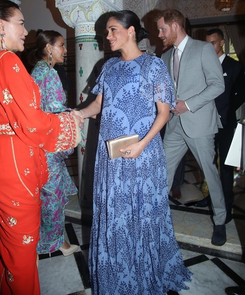 Meghan Markle wore Carolina Herrera floral printed silk chiffon short sleeve gown