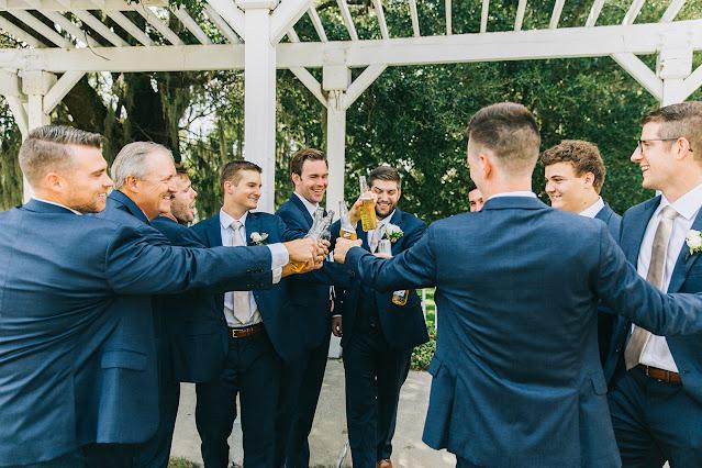 groom and groomsmen cheers
