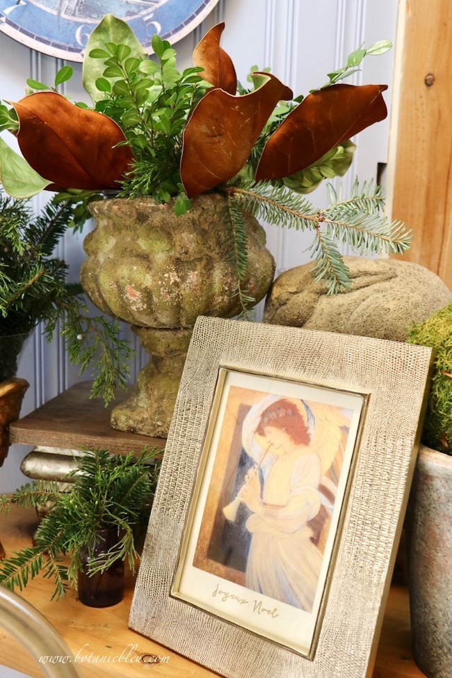 A large cement rabbit in the background behind a framed angel print will remain as part of Winter decor in January