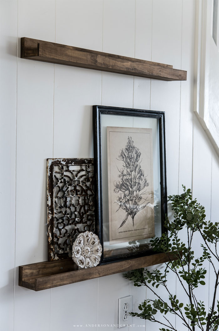 Decorated wood shelves on white wall