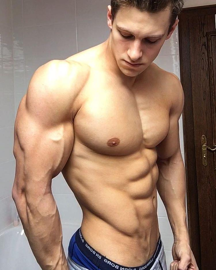 beefy-shirtless-muscle-dude-showing-gym-gains-huge-pecs-abs-veiny-arms-sexy-triceps