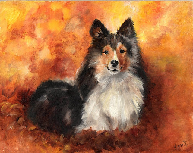 Sheltie surrounded by autumn leaves