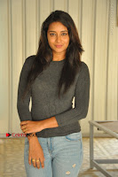 Actress Bhanu Tripathri Pos in Ripped Jeans at Iddari Madhya 18 Movie Pressmeet  0047.JPG