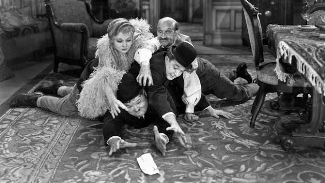Stan and Ollie fight over the deeds with Lola (Sharon Lynne) and Mickey Finn (James Finlayson)