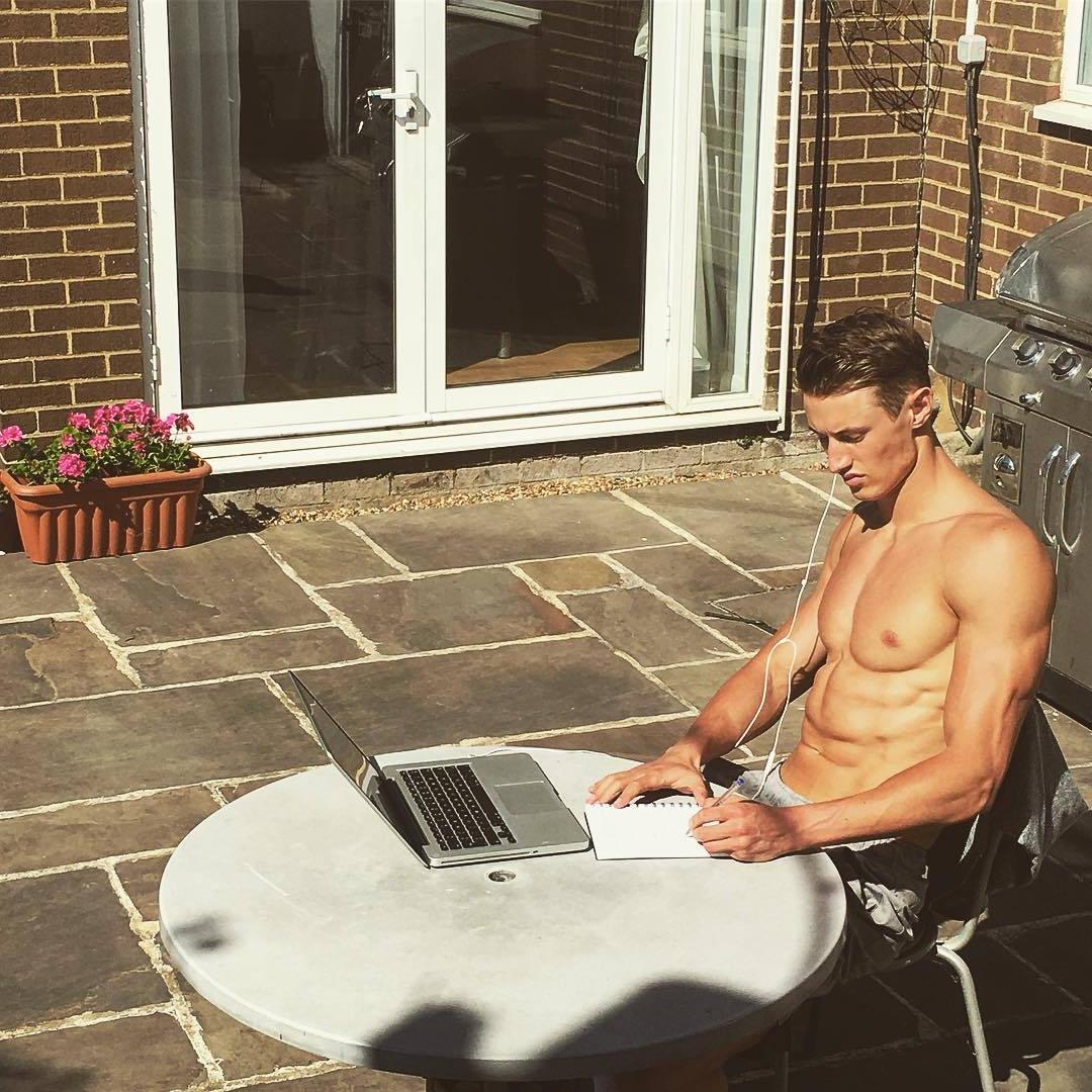 cute-bare-chest-boy-next-door-fit-body-sun-tanning-laptop-work-writing