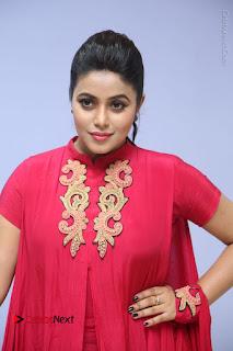 Actress Poorna Latest Stills in Red Dress at Rakshasi First Look Launch  0174.JPG