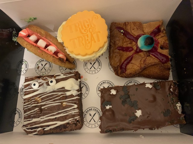 Halloween themed treat box, containing brownie, blondie, cupcake and cookie