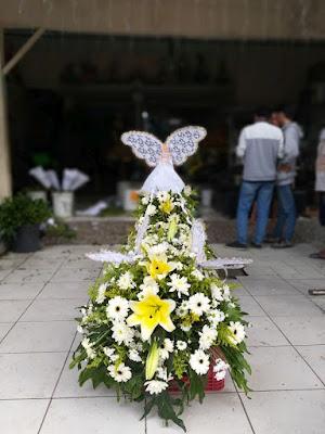 bunga tutup peti surabaya