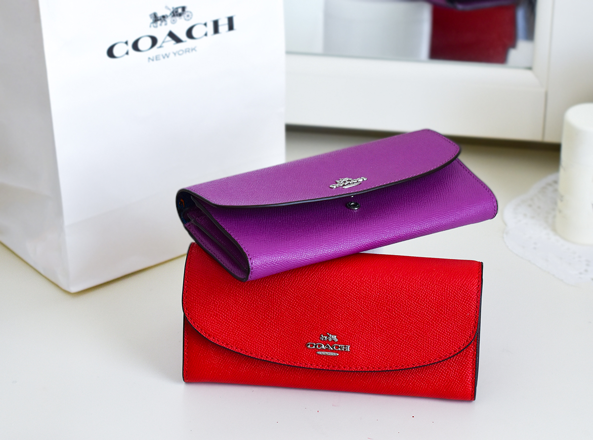 Coach red and purple wallets