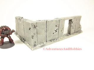 Battle damaged corner concrete wall section T593 with doorway for 25-28mm war games - exterior view - UniversalTerrain.com