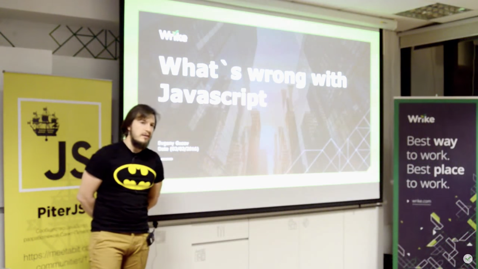 Image of Evgeny giving a public talk about the benefits of shifting to Dart