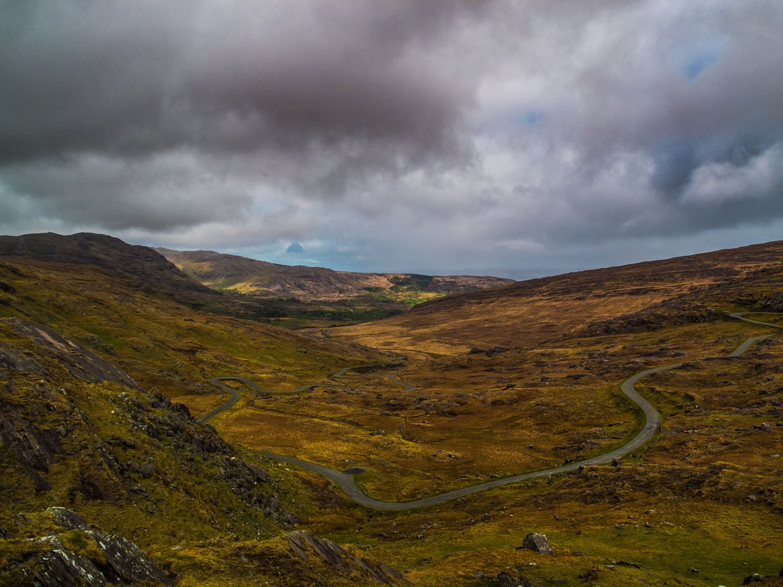 A view of the serpentine road called the Healy Pass in the Caha Mountain range.