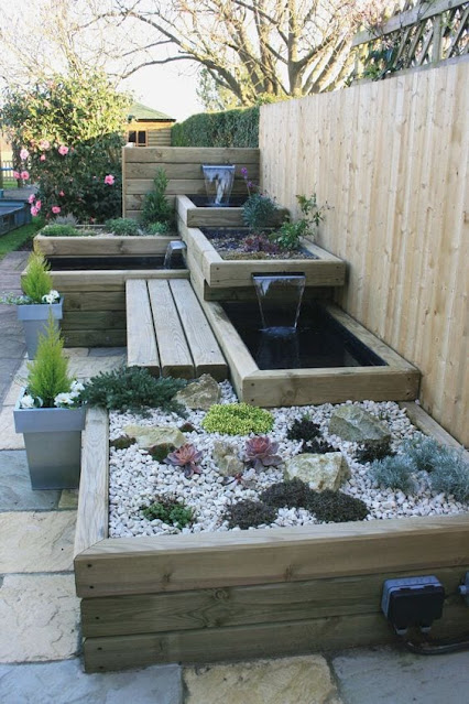 Custom Landscaped Water designed raised bed