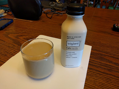 Soylent Cafe Vanilla, in a bottle and a clear glass