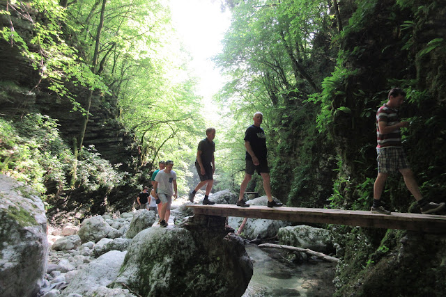 Crossing a bridge before the Kozjak waterfall, Slovenia