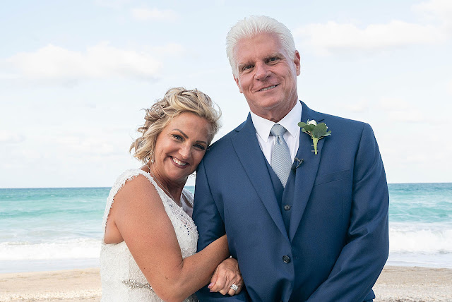 Portrait of Bride and Groom with the ocean behind them