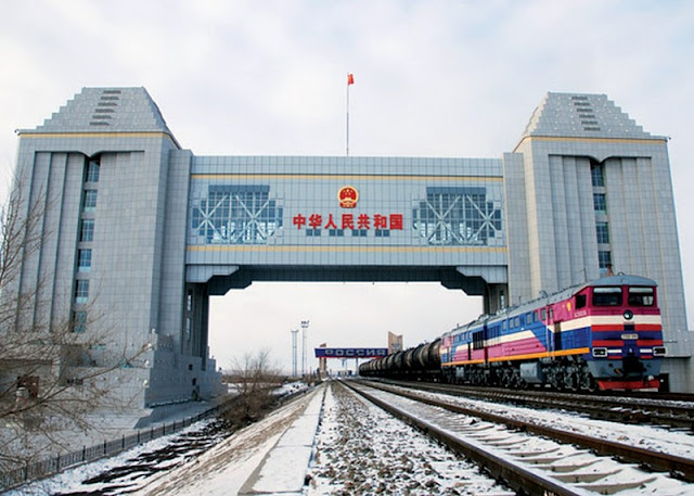 Image Attribute: Chinese Freight Train crossing an International Border / Creative Commons