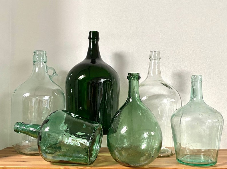 A collection of vintage glass carboys