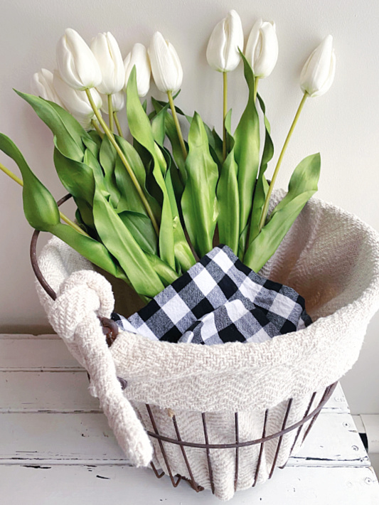 basket with long stemmed tulips