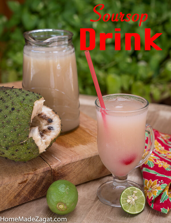 Jug of soursop juice with soursop and a glass of soursop drink