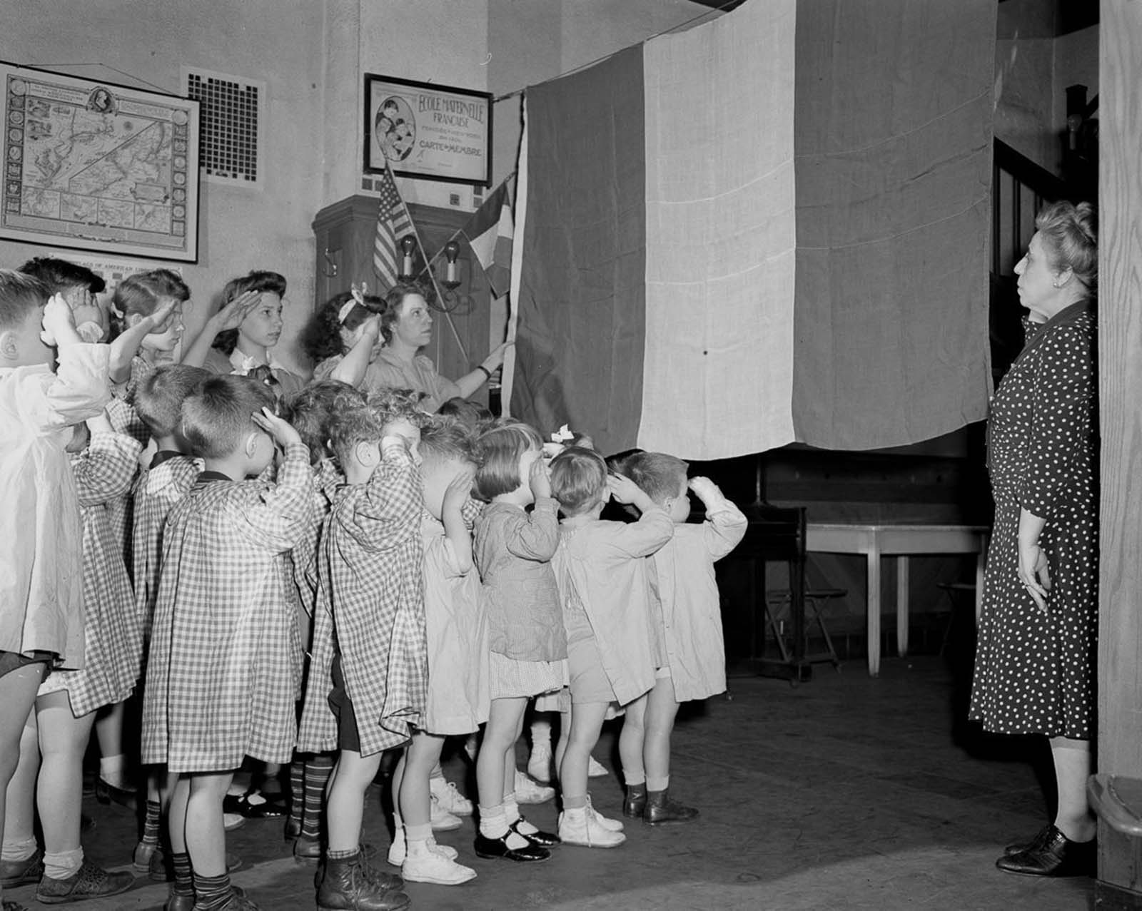 Children salute the French flag at a French school in Manhattan.