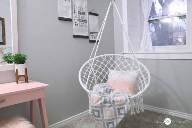 pink desk and hanging swing in girls room
