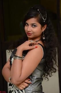 Shrisha Dasari in Sleeveless Short Black Dress At Follow Follow U Audio Launch 074.JPG