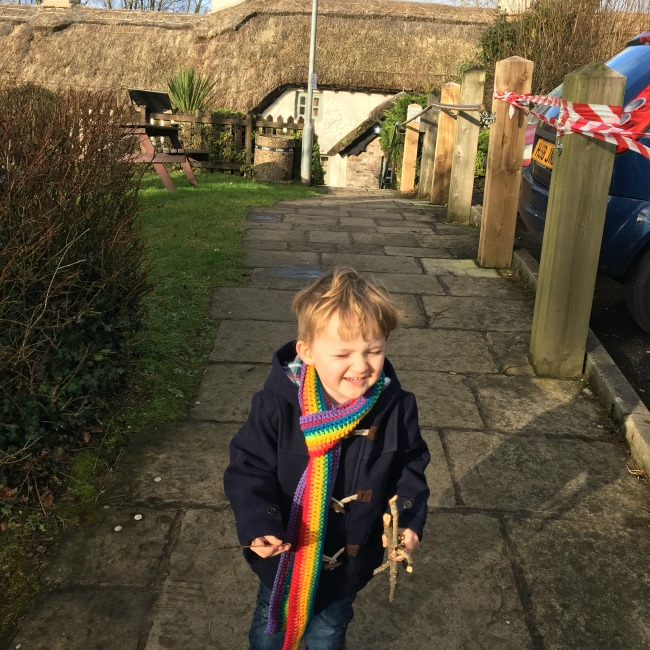 Our-weekly-journal-16th-jan-2017-toddler-with-sticks-outside-travellers-rest-caerphilly