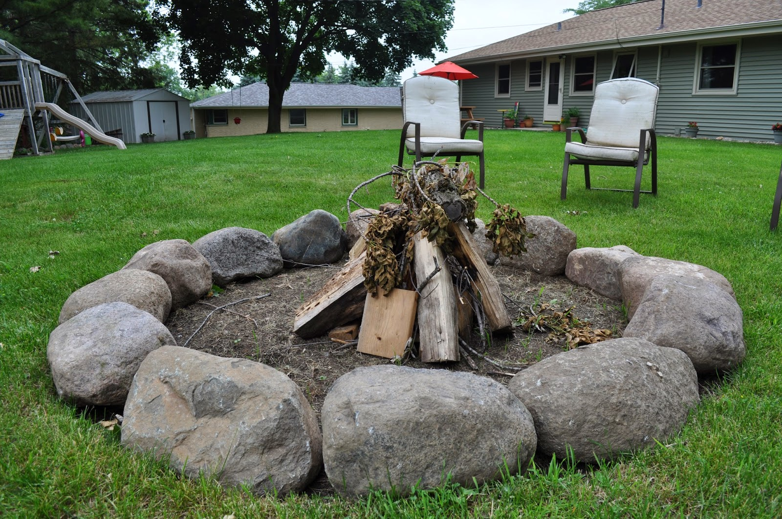 Carri us home field stone fire pit for What rocks to use for fire pit