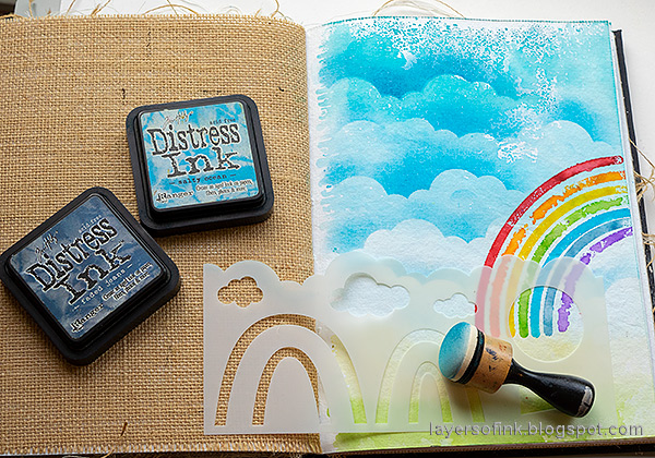 Layers of ink - Rainbow Art Journal Page by Anna-Karin Evaldsson. Sponge ink to create clouds.