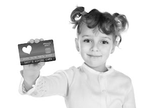 Girl holding giving prepaid debit card