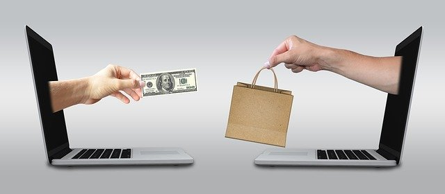 Online shopping, exchanging money for goods through computers.