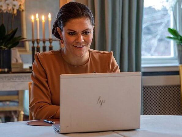 Princess Victoria wore a camel silk blouse from By Malene Birger, By Malina and Filippa K crepe blouse