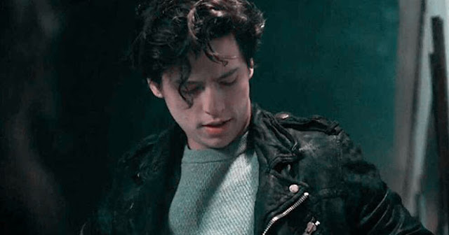 JUGHEAD PUTTING ON HIS SERPENTS JACKET