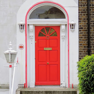 Orange Dublin door with matching trim in Sandymount