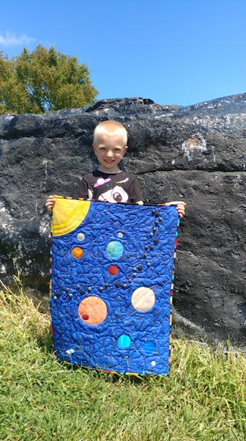 Outer space quilt made by a six year old boy
