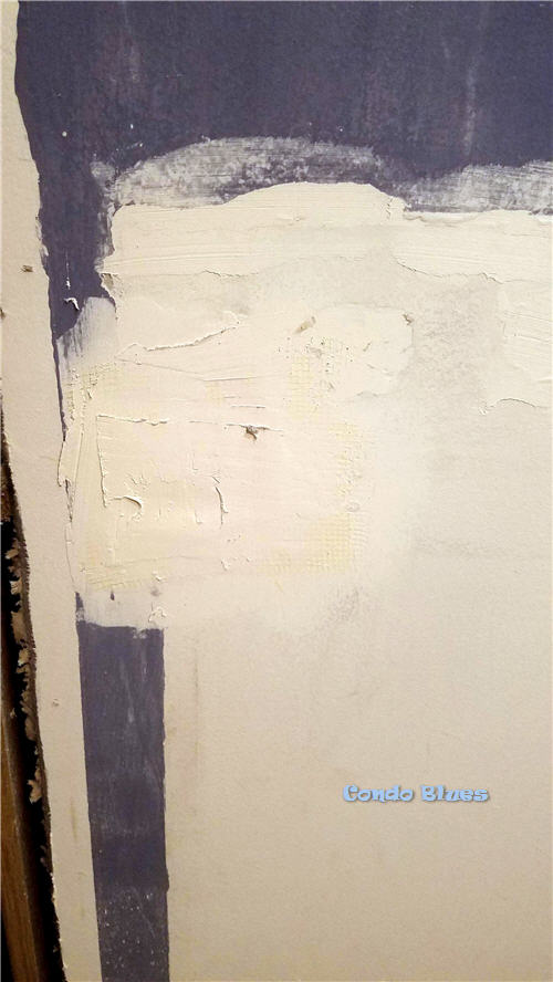 how to repair holes in a wall