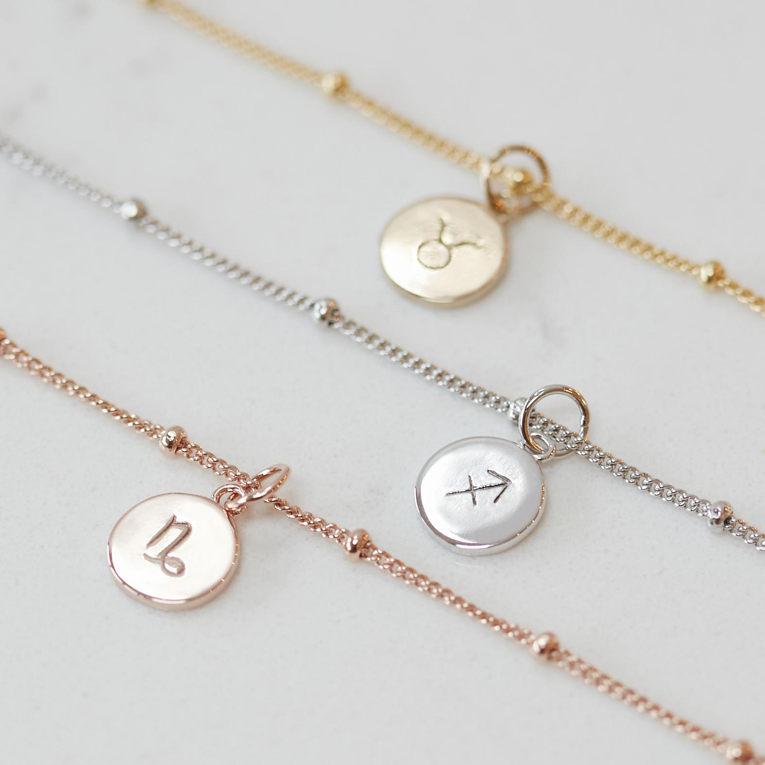 Muru Jewellery Three Zodiac Bracelets Laid Out