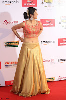Harshika Ponnacha in orange blouuse brown skirt at Mirchi Music Awards South 2017 ~  Exclusive Celebrities Galleries 108.JPG