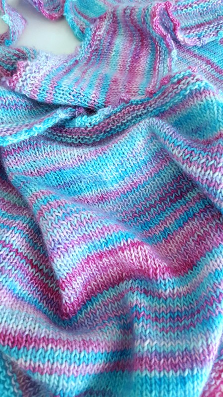 Beautiful hand knitted shawl in hand-dyed yarn.
