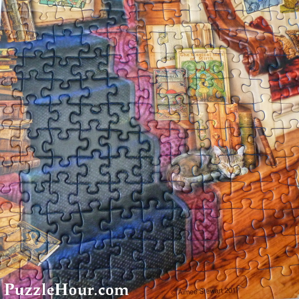 Jigsaw puzzle Ravensburger the Fantasy Bookshop staircase sleeping cat books