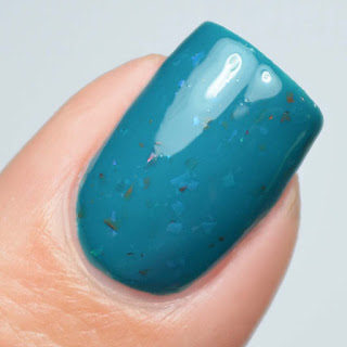 teal nail polish with color shifting flakies