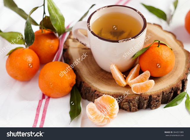 http://www.shutterstock.com/pic-364251089/stock-photo-cup-of-green-tea-and-fresh-mandarins-on-white-rustic-background-shallow-focus.html