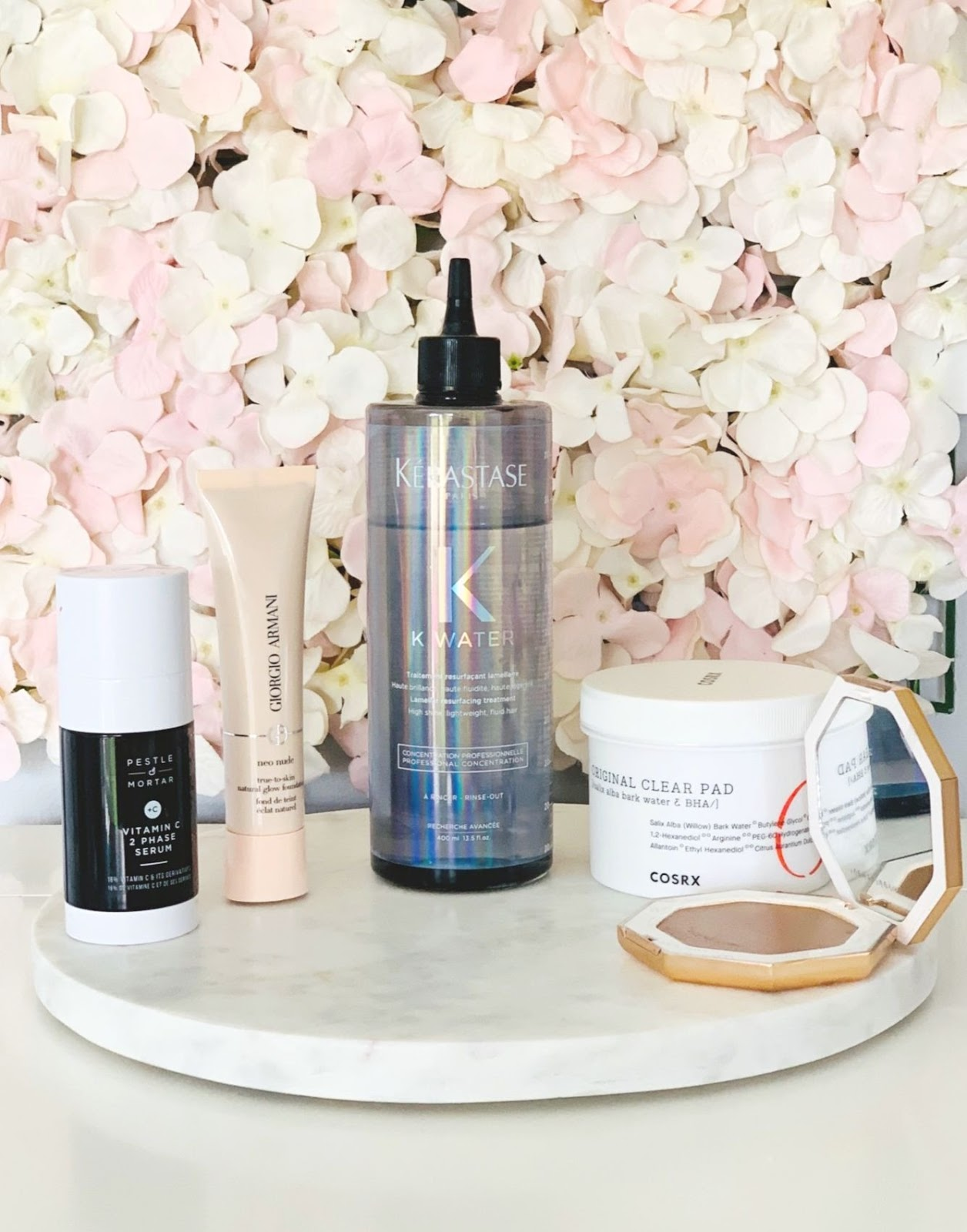 Five products I'm currently loving, Kerastase K-Water, Armani Neo Nude Foundation, COSRX Original One Step Original Clear Pads, Pestle & Mortar Vitamin C 2 Phase Serum, Fenty Beauty Cream Bronzer