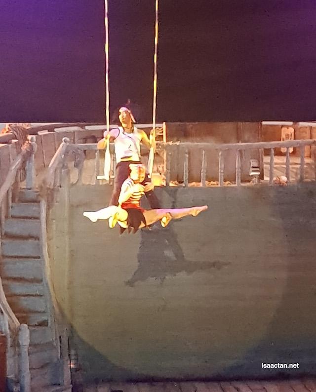 A comical pirate act high up