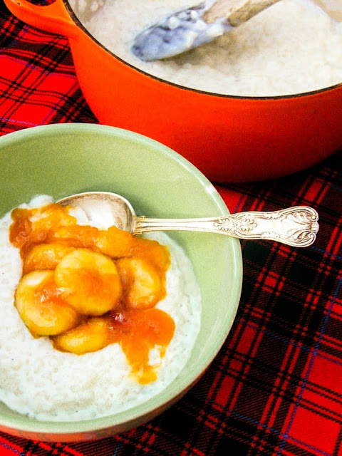 Creamy Rice Pudding with Toffee Bananas in a green bowl on a red tartan tablecloth