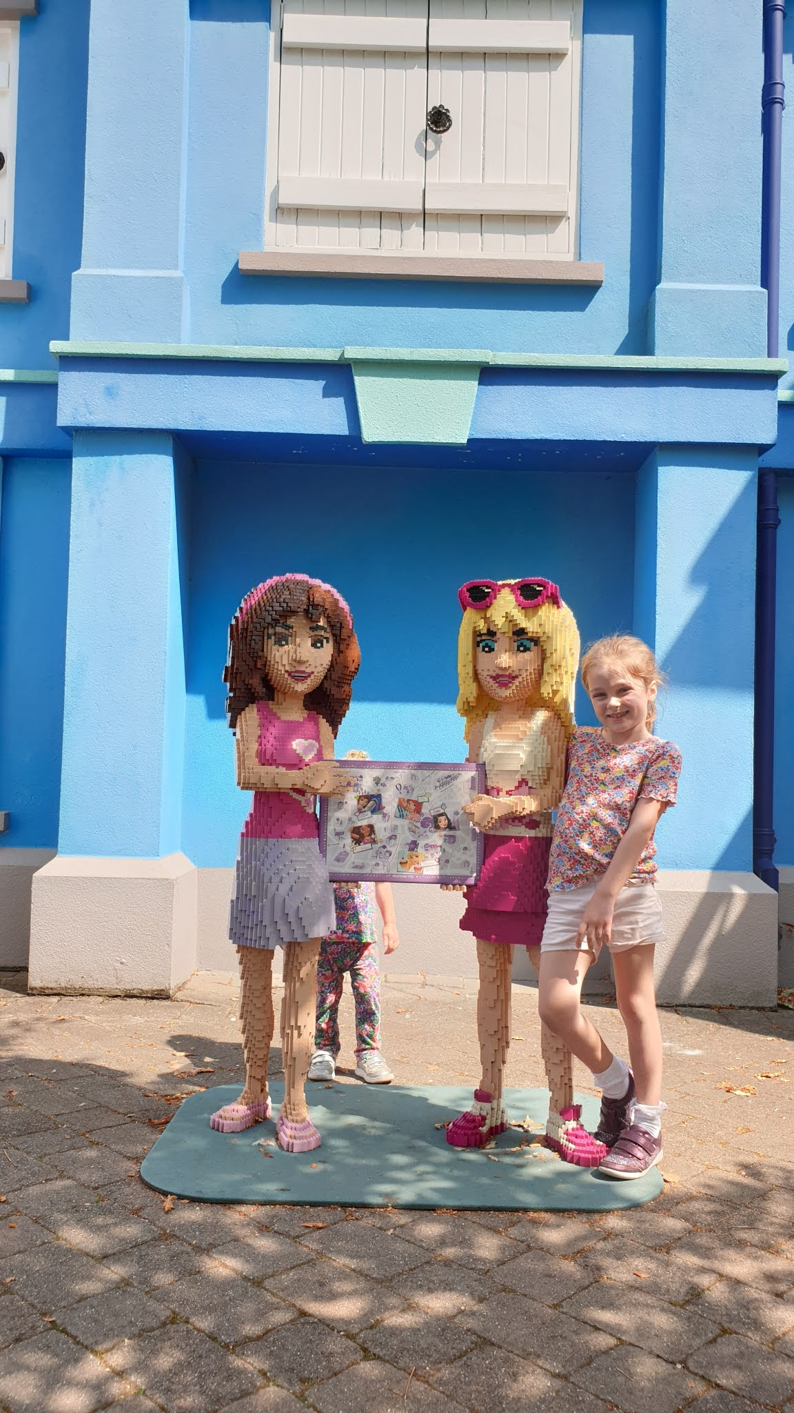 kids with lego friends sculptures