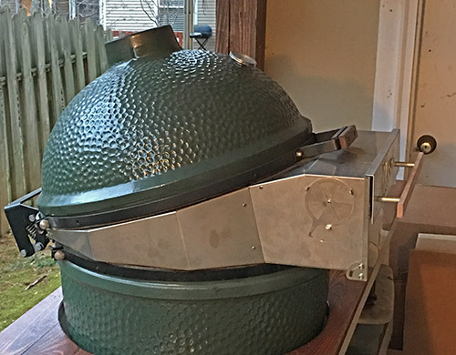 Side view of a Big Green Egg with the Pizza Porta warming up.