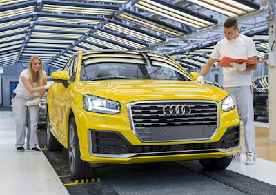 A Small Car Makes A Big Impression The New Audi Q - What company makes audi cars